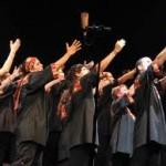 gospel singers extending hands